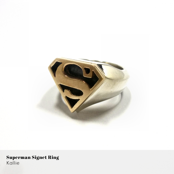 Gold and sterling silver Superman signet ring from Kallie on Hello Pretty