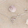 Silver Wistful Wave Necklace with Rose Quartz and Blue Topaz Gemstones by La Mae Jewellery