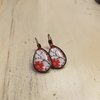 Red Flowers in red Bronze by JanaS