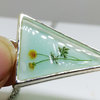 Delicate Flower Resin Pendant on minty background by Honeydog Designs