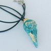 Bird skull with gold leaf resin Pendant by Honeydog Designs