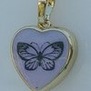 Small Heart pendant with Butterfly detail  by Honeydog Designs