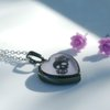 Small Heart pendant with skull detail and pink background by Honeydog Designs