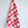 """Apples"" tea towel in coral and pink by i Spy"