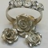 Handmade sterling silver rose band ring by Charli Design Studio