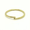 Brass 'criss cross' ring by a ring to it