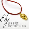 Brass Skull Necklace on red leather Cord by Eon Hoon Jewellery Design