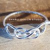 Sterling silver double knot by Charli Design Studio
