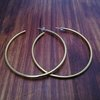 Brass Hoop Earrings  by a ring to it