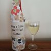 Wine bottle holder by Imagine Creations