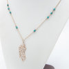 Gold feather turquoise neckalce  by Nicole Jordan Designer  Jewellery