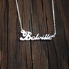 "Silver suburb ""name tag"" necklace by a ring to it"