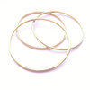 Plain Brass Bangle by a ring to it