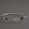 "Blue Sapphire and Sterling Silver ""Sisters Bangle"" by Chongo and Wells Silver"