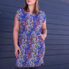 Spring Floral Elastic Dress with curved pockets and hem detail by Misc. Clothing