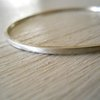 delicate silver bangle by thula