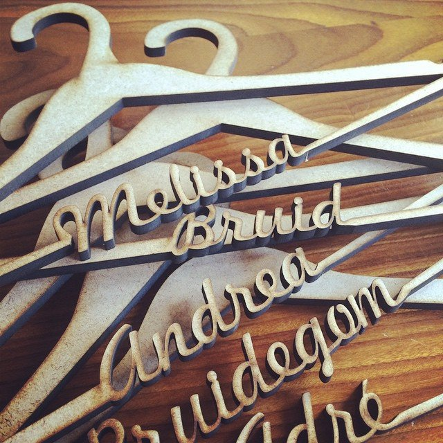 Laser Cut hangers by Laser Creations