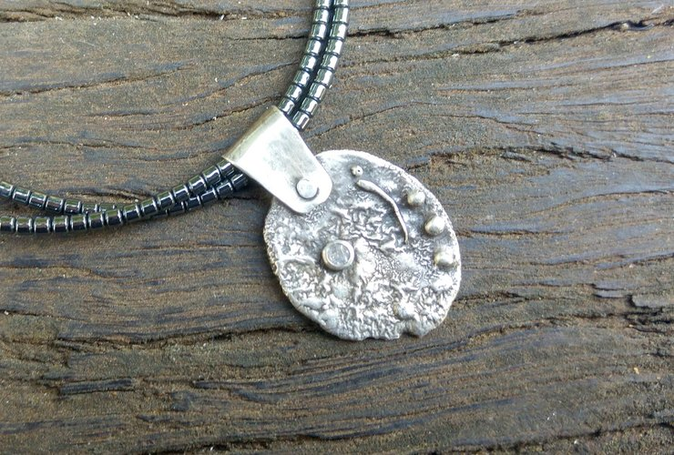 Reticulated Stirling Silver medallion with Zircon by Cecilia Robinson Jewellery