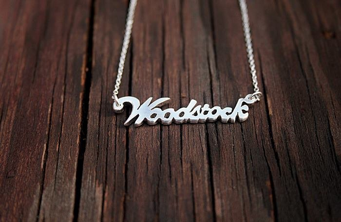 "Silver ""name tag"" necklace (5 characters) by a ring to it"