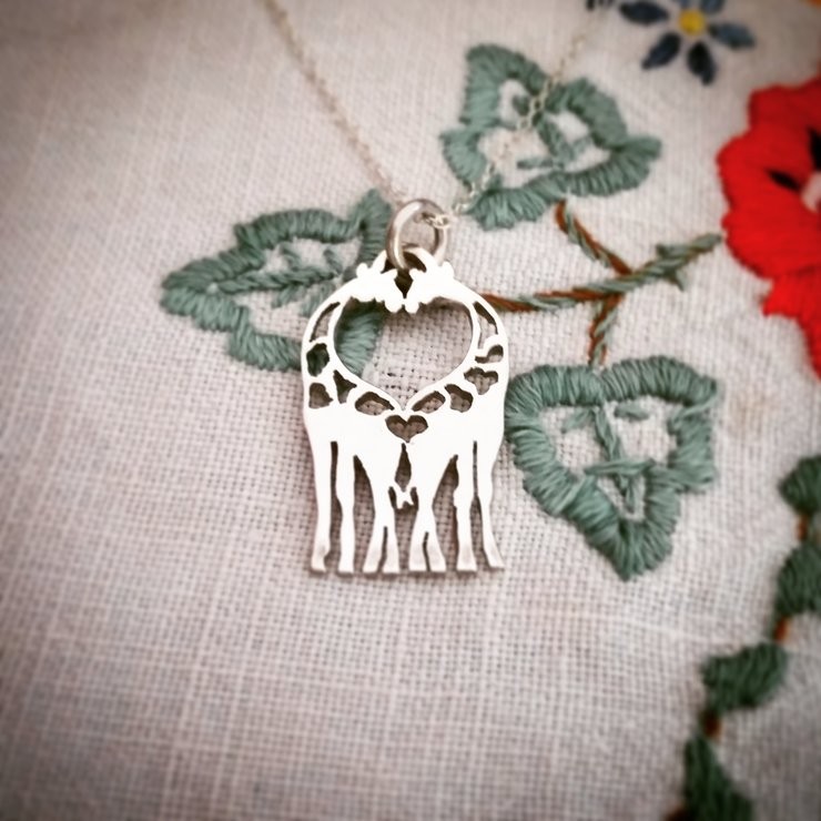 Handmade sterling silver large kissing giraffes necklace by GloveJewellery