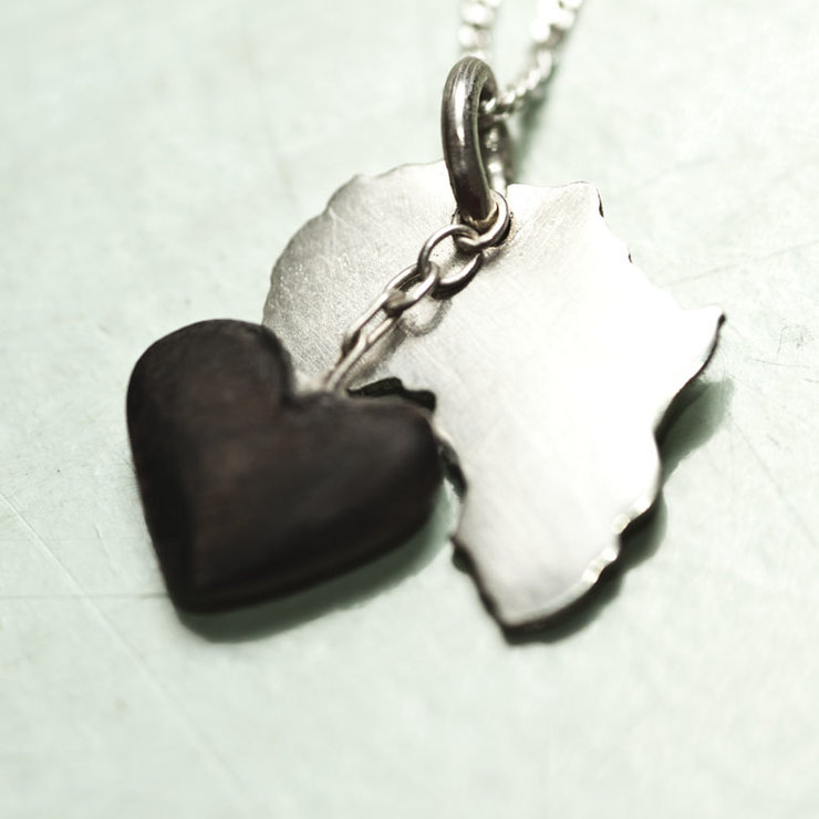 Silver africa pendant with a dangling african black wood heart silver africa pendant with a dangling african black wood heart by natasha wood jewellery aloadofball Images