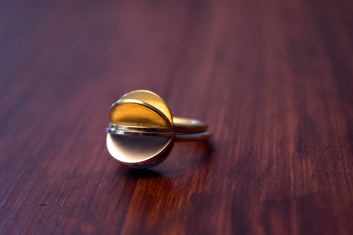 Silver 'half sphere' ring by a ring to it