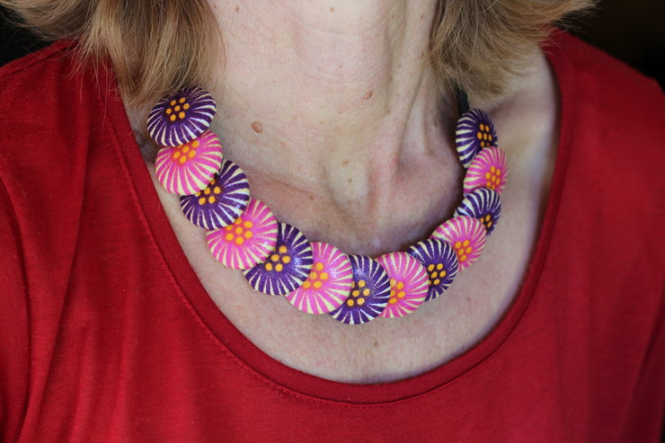 Button necklace with satin ribbon and African print fabric