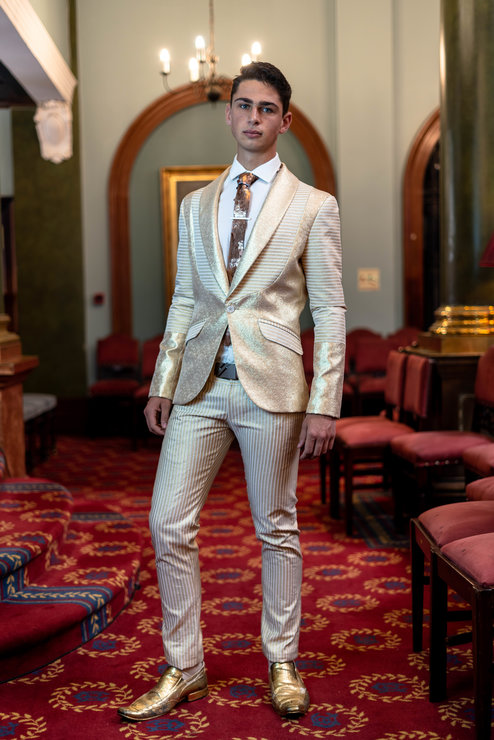 YB58: Gold and white stripe detailed, slim-fit, jacket with matching trousers. by Yihan Brönn Couture