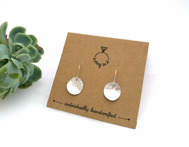 Silver smithing dangle earring (small) by a ring to it