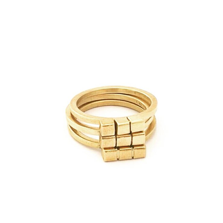 Brass 'puzzle stack' rings (set of 3) by a ring to it