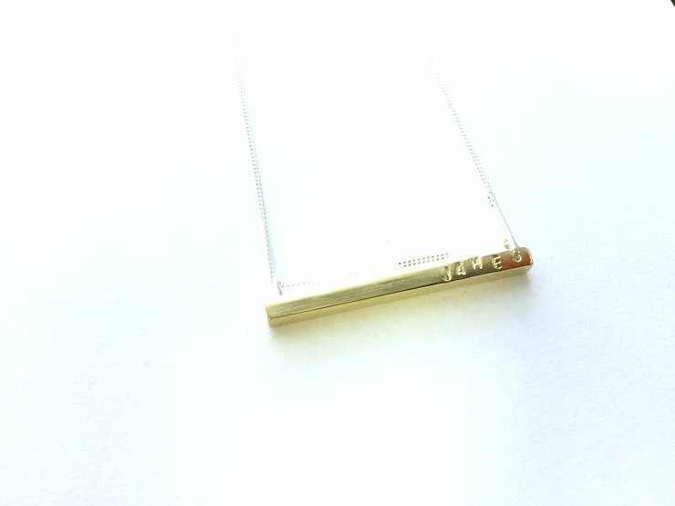 Custom brass bar pendant by a ring to it