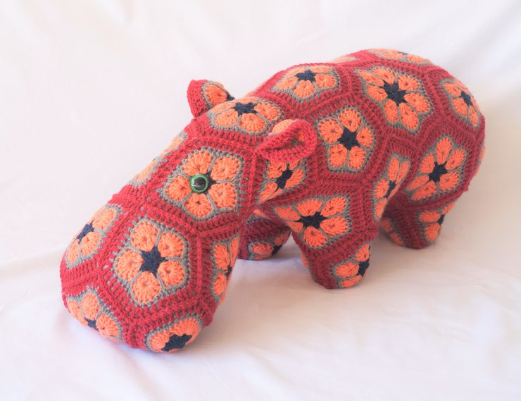 Happypotomus, the african daisy crocheted hippo soft toy. doorstop or decor item by needle nerds