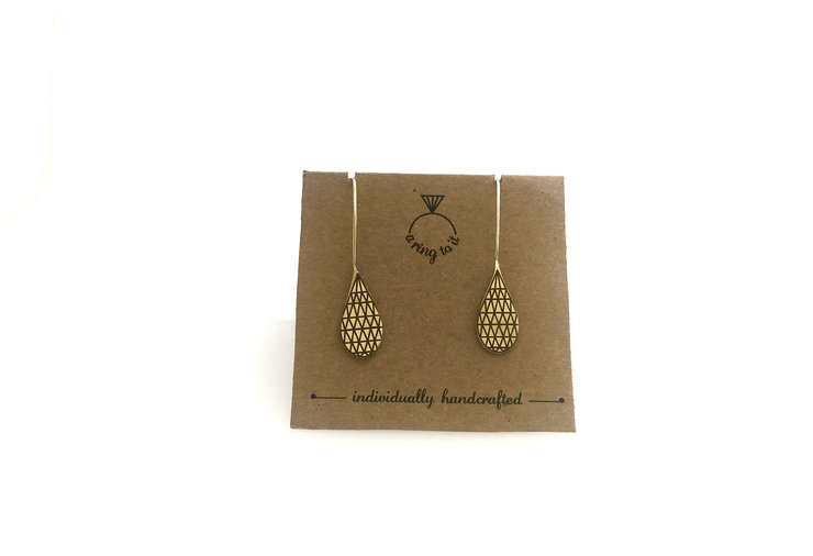 brass 'stone engraved' drop earrings by a ring to it