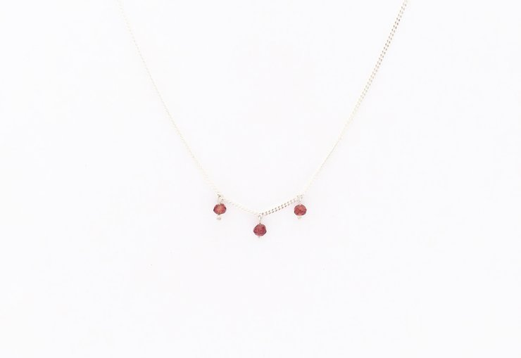 Silver &  garnet 'trio' choker by a ring to it