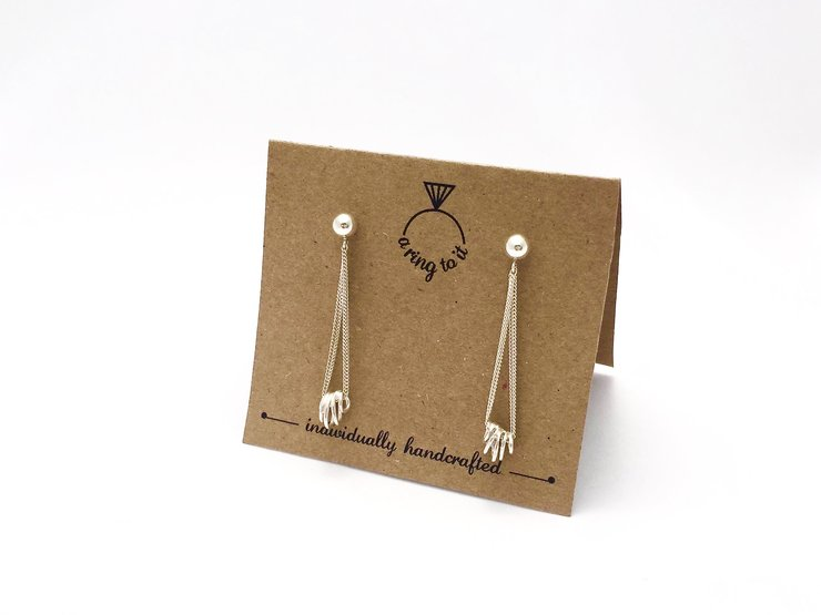 Silver 'swirl' dangle earrings by a ring to it