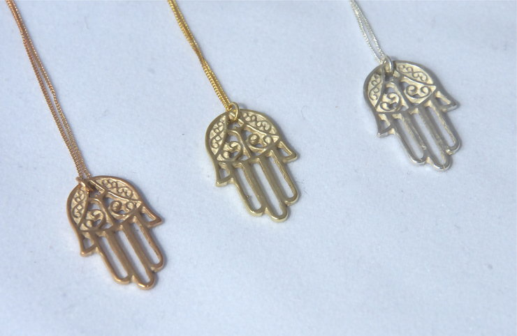 material hamsa necklace main product hand