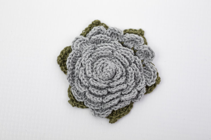 Crochet blue flower brooch by Annemae