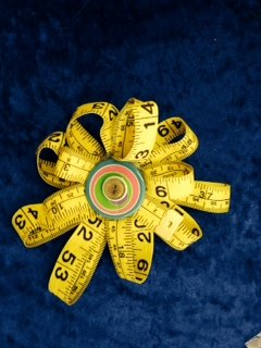 upcycle tape measure brooch by The Rusty Chicken Crafts