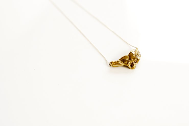 Brass 'bubblegum' bib pendant on silver chain by a ring to it