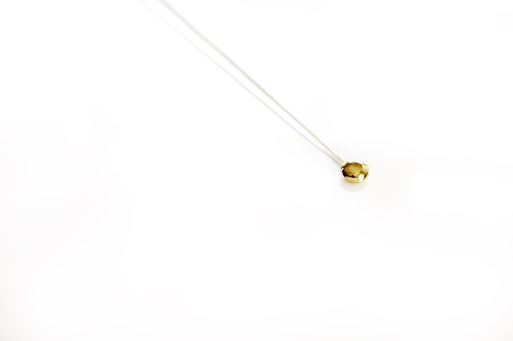 Brass 'sweetie' pendant by a ring to it