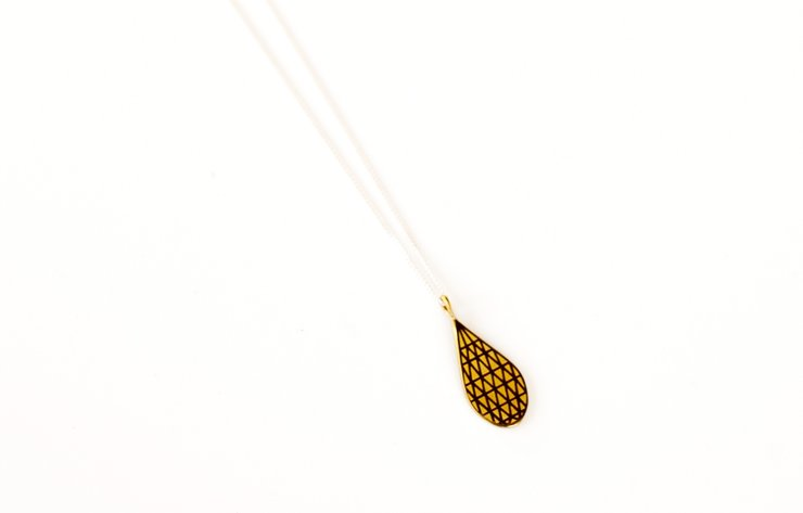Brass 'stone' drop pendant by a ring to it