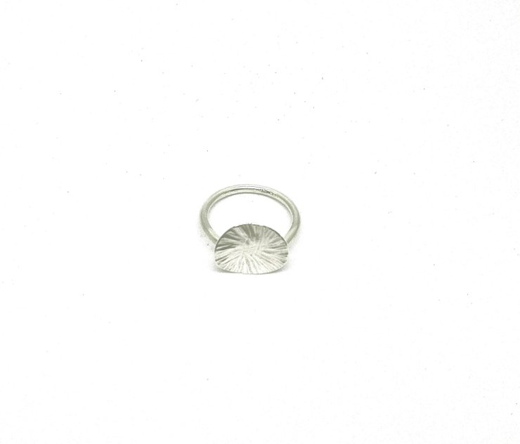 Silver Smithing Ring by a ring to it