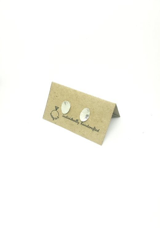 silver smithed earrings (large) by a ring to it