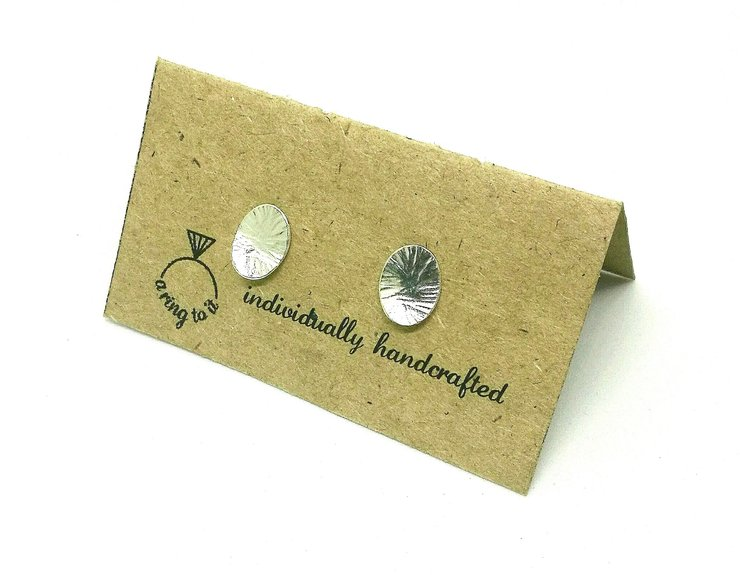 Smithed silver earring studs (medium) by a ring to it