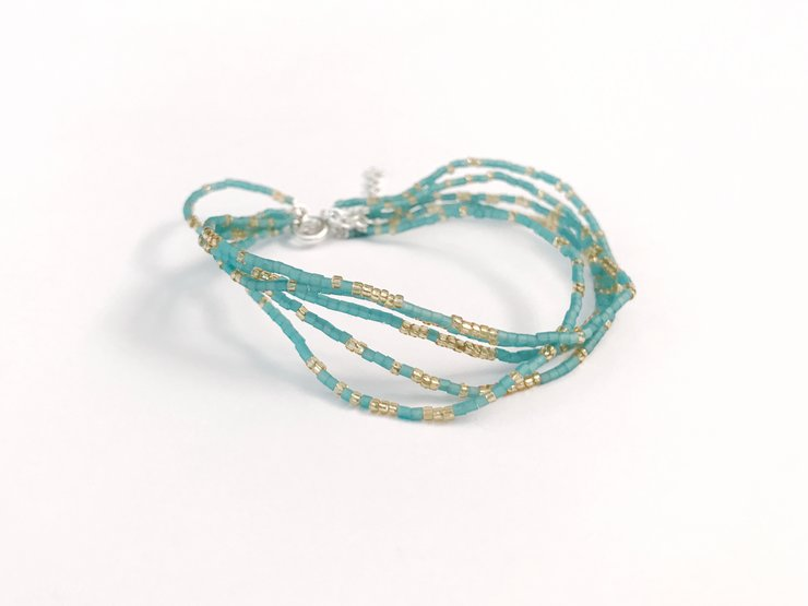 Sterling Silver Wire Bracelet with Gold & Turquoise Micro-Beads by Trixie Washington