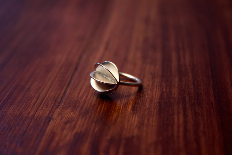 Silver 'sphere' ring  by a ring to it