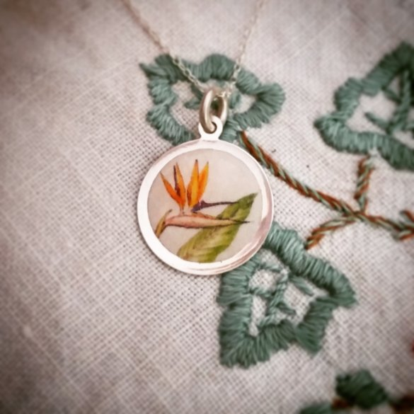 Handmade sterling silver strelitzia picture disc necklace