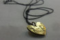 A Limited Edition 18 K Gold, 1 Cent Coin Heart Pendant  by Kallie